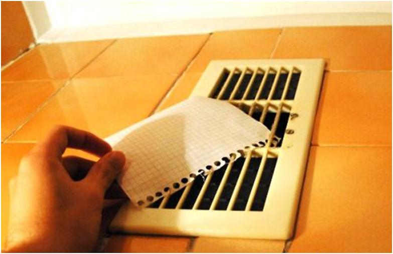 Проверка вытяжки при помощи бумаги