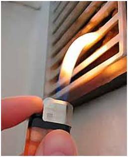 Зажигалка возле вентиляционной решетки