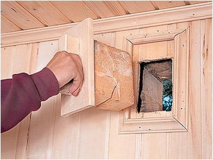 Вытяжное отверстие в стене дома